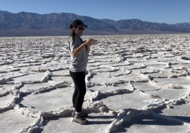 Lexi takes pictures of the salt flats in Badwater Basin in Death Valley